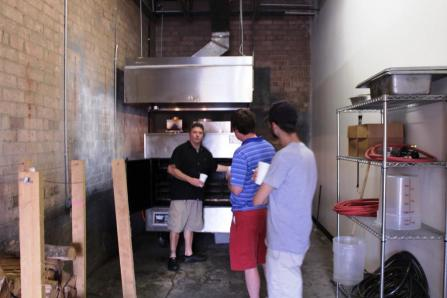 Boone showing us around the commissary and Southern Pride smoker