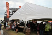 Across the pathway, the Traeger Grills team and tent